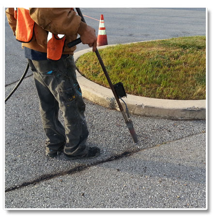 Crack sealing asphalt clean out